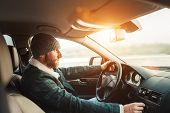 Inside Car View Of Warm Dressed Bearded Man Driving A New Modern Lhd Drive Auto And Makes Car Audio  poster