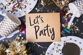 Lets Party Brush Stroke Handwriting On Golden Greeting Card With Party Cup,party Blower,tinsel,conf poster