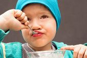 Children Eating With A Spoon Delicious Dessert Portrait Happy Childhood Nutrition Child Eating Taste poster
