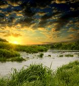 stock photo of fantasy landscape  - Evening scene on river - JPG