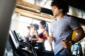 Beautiful Fit People Exercising Together In Gym poster