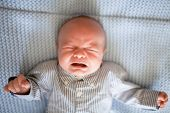 Crying And Screaming Hungry And Angry Little Newborn Baby Boy. poster