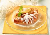 Apple danish pastry with frosting on the plate