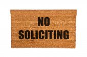 foto of soliciting  - A no soliciting doormat isolated on a white background - JPG