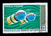 MONGOLIA - CIRCA 1965: A stamp printed in Mongolia shows the Soviet spaceship Vostok-2, circa 1965