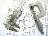 stock photo of micrometer  - Engineerin tools on technical drawing - JPG