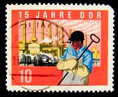 GDR - CIRCA 1964:A stamp printed in East Germany showing the image of metallurgist, series, circa 19