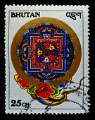 BHUTAN - CIRCA 1990s: A stamp printed in Bhutan shows traditional pattern, circa 1990s