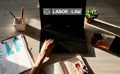 Labor Law Icon And Text On Device Screen. poster