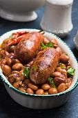 Cooked brown kidney beans stew with pork sausage poster