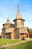 stock photo of deacon  - wooden church under the blue sky - JPG