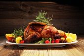 Baked Turkey Or Chicken. The Christmas Table Is Served With A Turkey, Decorated With Fruits, Salad A poster