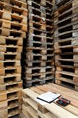 Wooden pallets in a factory yard