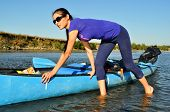 stock photo of canoe boat man  - Young girl pulling a canoe - JPG
