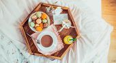 Breakfast In Bed With I Love You Text On A Note. Cup Of Coffee, Juice, Macaroons, Rose And Giftbox O poster