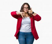 Beautiful plus size young business woman wearing elegant jacket and glasses over isolated background poster