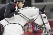 BUDAPEST, HUNGARY - DECEMBER 3: An unidentified competitor jumps with his horse at the OTP Equitatio