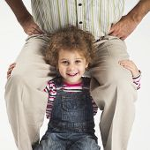 Happy Toddler Girl Holding Father On Shoulders