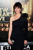 NEW YORK  - DECEMBER 07: Actress Carla Gugino poses for a photo during the 'New Year's Eve' premiere at Ziegfeld Theatre on December 7, 2011 in New York City