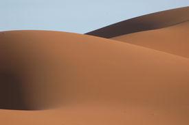 stock photo of sahara desert  - the sand dunes of erg chebbi in the sahara desert near the village of merzouga in morocco - JPG