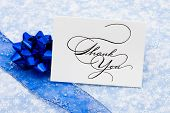 image of thank you card  - Thank you card with ribbon and bow on blue snowflake background thank you card - JPG