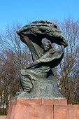 stock photo of chopin  - Frederic Chopin Monument on blue sky in Warsaw Poland - JPG