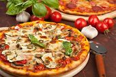 Super healthy vegetables and mushrooms pizza and salami pizza at the back