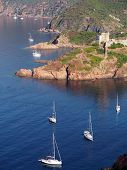 Sailboat and Girolata Genovese Fort , Corsica , France
