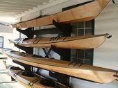 hand made wood kayaks on racks