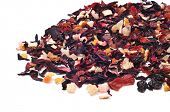 closeup of pile of a mix of dry fruits, as papaya and pineapple, and flowers, as hibiscus, to prepare herbal tea