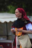 Portrait Of A Female Troubadour On Stilts
