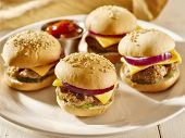 platter of mini burger sliders with ketchup,
