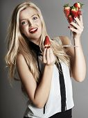 pic of strawberry blonde  - Pretty blonde girl holding glass of Strawberries - JPG