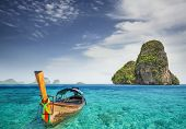 stock photo of long beach  - Railay beach in Krabi Thailand with boat - JPG