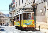Traditional Lisbon Yellow Tram Decorated With Sardines During Popular Saints Festival