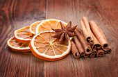 stock photo of christmas spices  - Sliced of dried orange anis and cinnamon - JPG
