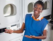Portrait of young African American female helper welcoming in laundry