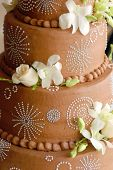Close Up Of Wedding Chocolate Cake With Fresh Flowers