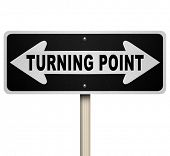 A road sign with the words Turning Point and arrows pointing left and right representing an importan