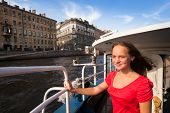 Teen girl on boat along channels St. Petersburg