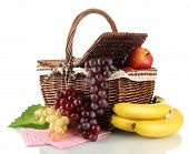 Picnic basket with fruits isolated on white