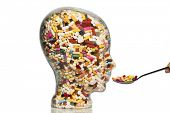 stock photo of drug addict  - a glass head filled with many tablets - JPG