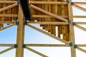 stock photo of rafters  - wooden roof construction - JPG