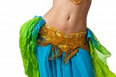 image of up-skirt  - Close up shot of a belly dancer wearing a blue gold and green costume shaking her hips - JPG