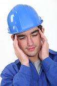 Builder suffering from tension headache
