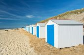Row blue and white beach cabins for vacation supposes