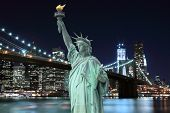 Brooklyn Bridge and The Statue of Liberty at Night, New York City