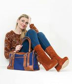 stock photo of platform shoes  - sitting woman wearing fashionable platform brown shoes with a handbag - JPG