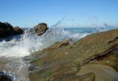 Waves Splashing over Rocks