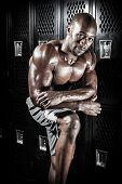 foto of jamaican  - Portrait of a lean toned and ripped muscle fitness man under dramatic low key lighting - JPG